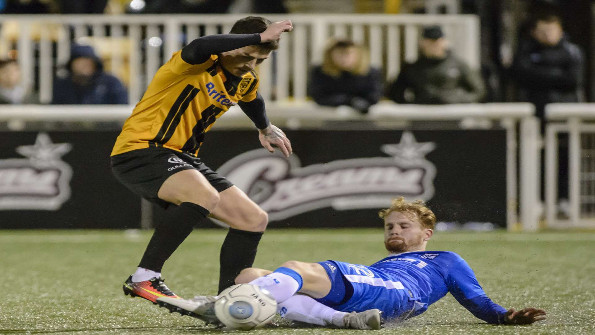 Gillingham's Connor Ogilvie tackles Maidstone's Jack Paxman Picture: Andy Payton