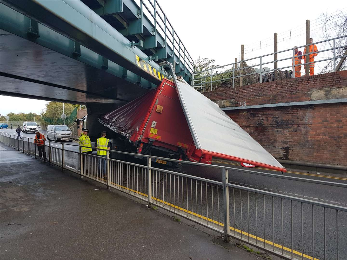 The top of the lorry has collapsed after it hit Newtown Road bridge (18826504)