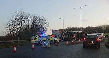 A lorry has overturned near the roundabout
