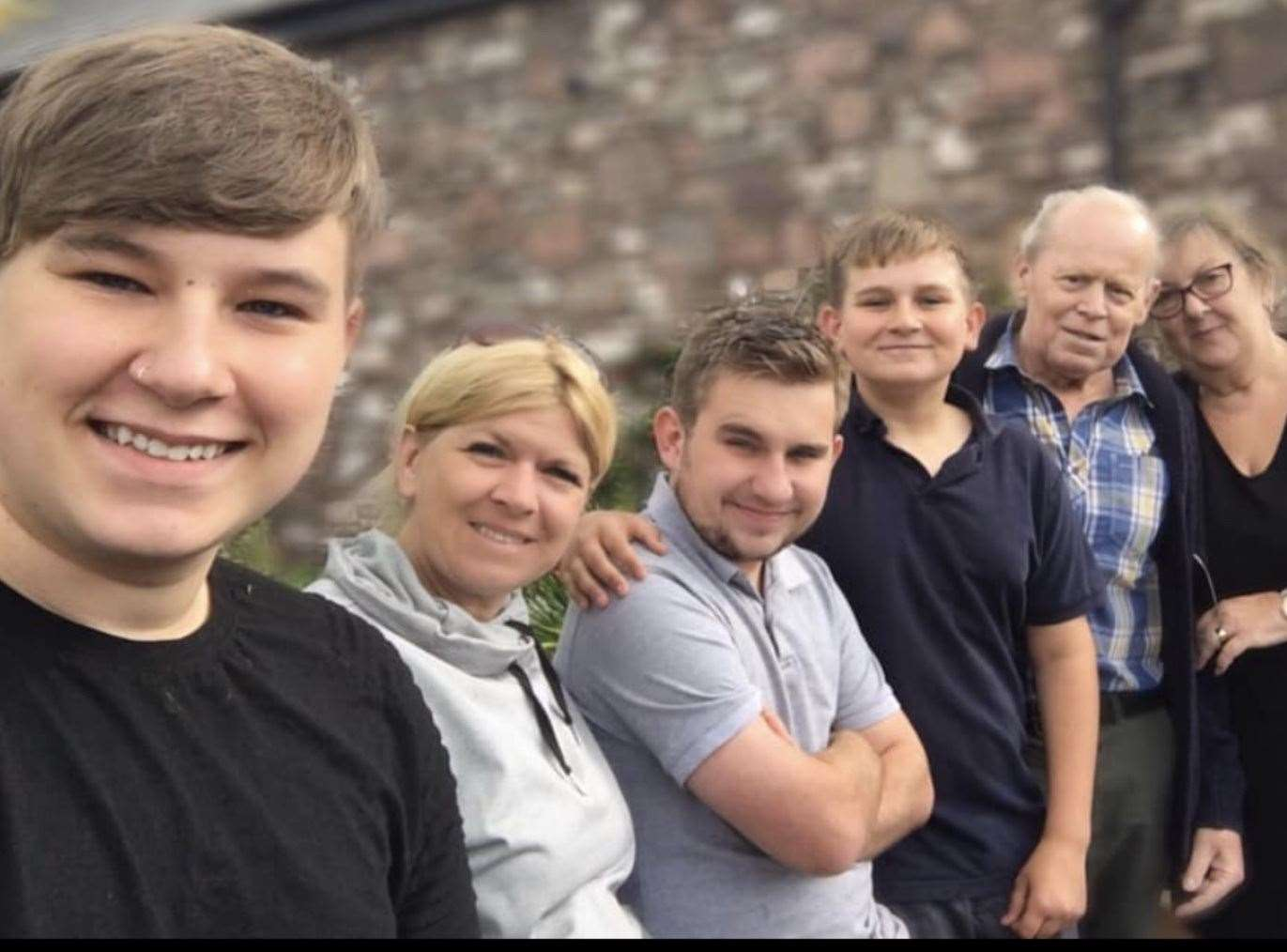Glyn Moon, with his wife Susan, daughter Melanie and three grandsons Ryan, Jamie and Sam