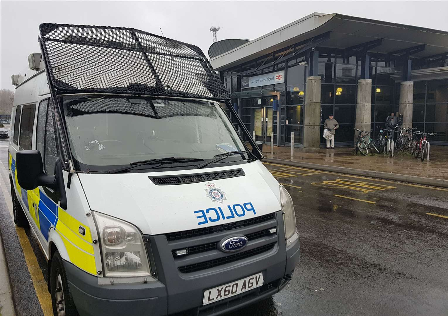 A police van is currently parked outside Ashford International station