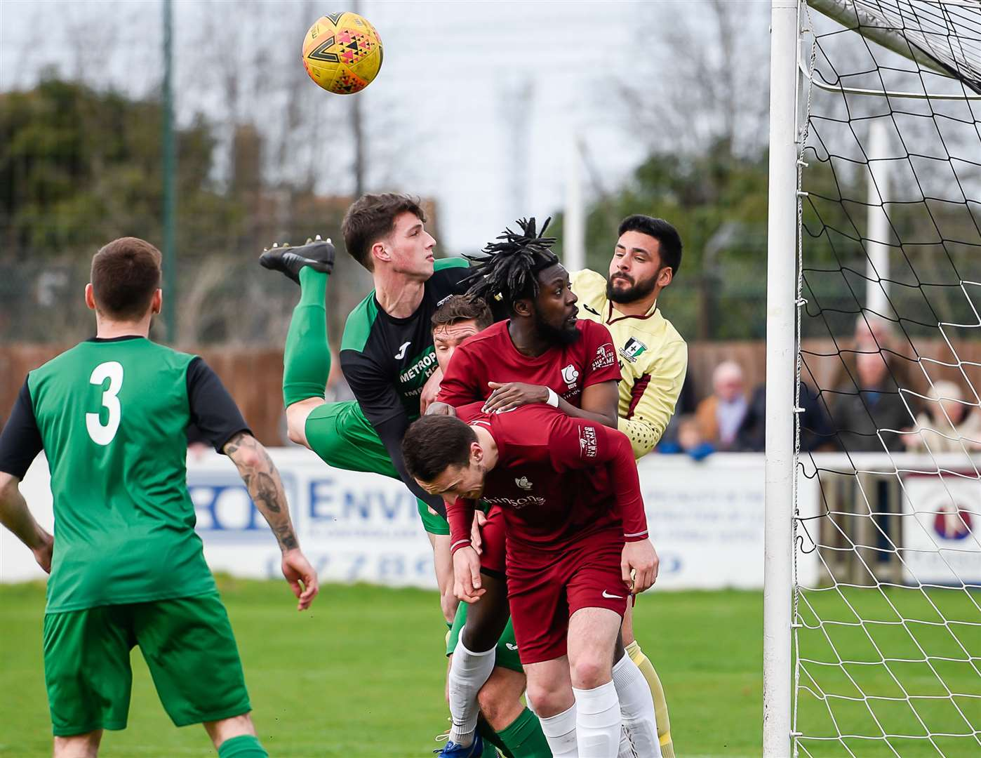 Cray Valley keeper Deren Ibrahim punches clear under pressure from one of Ryan Cooper's long throws Picture: Alan Langley