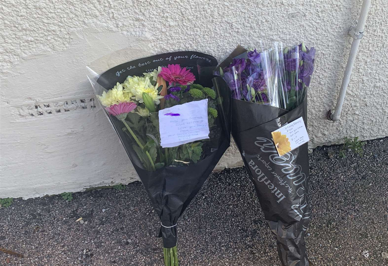 Tributes left outside the house in Richmond Road, Gillingham, where a woman was found dead