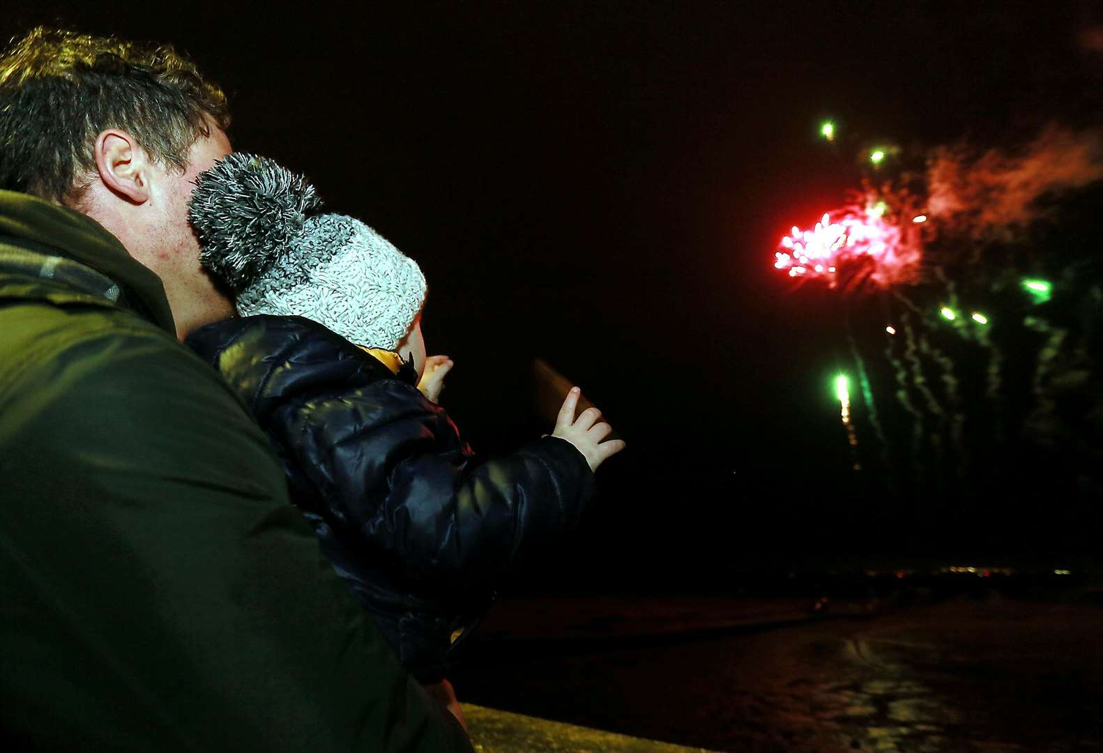 Young and old loved the free fireworks display at Queenborough's Christmas lantern parade on Sunday. Picture: Phil Lee