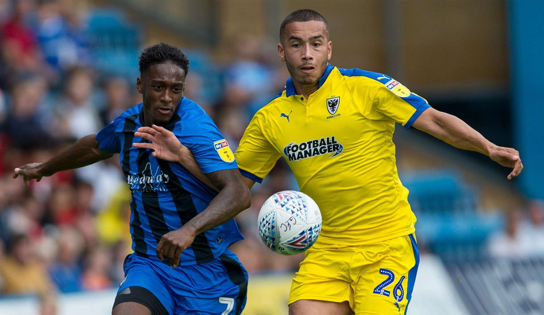 Brandon Hanlan challenges with AFC Wimbledon's Rod McDonald Picture: Ady Kerry