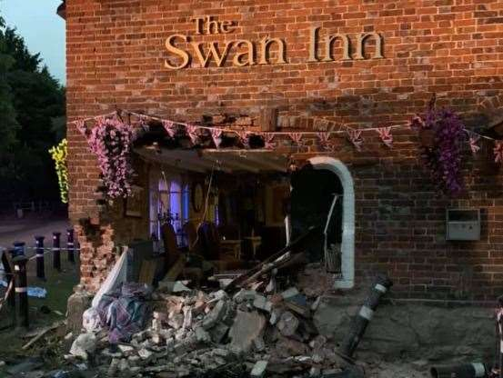 A gaping hole was left in the side of the The Swan Inn following the crash