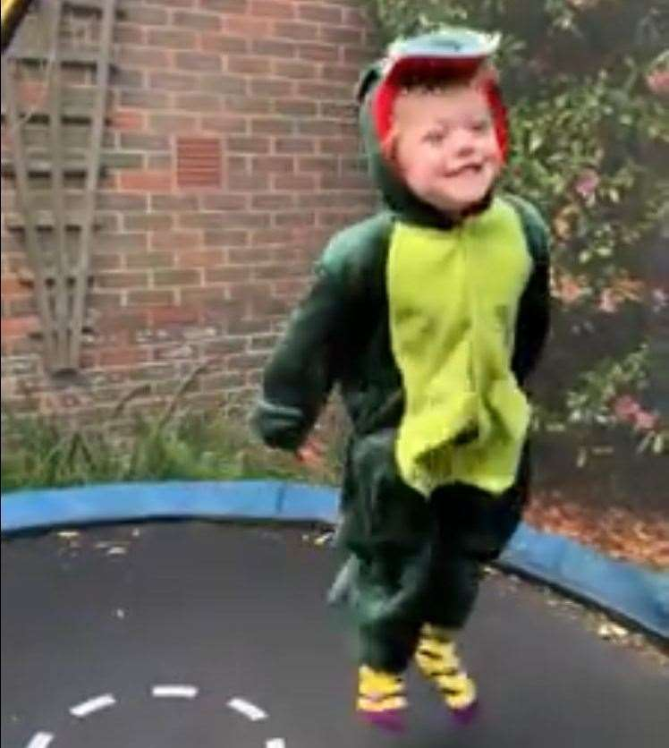 Theo sometime likes to bounce dressed as a dragon