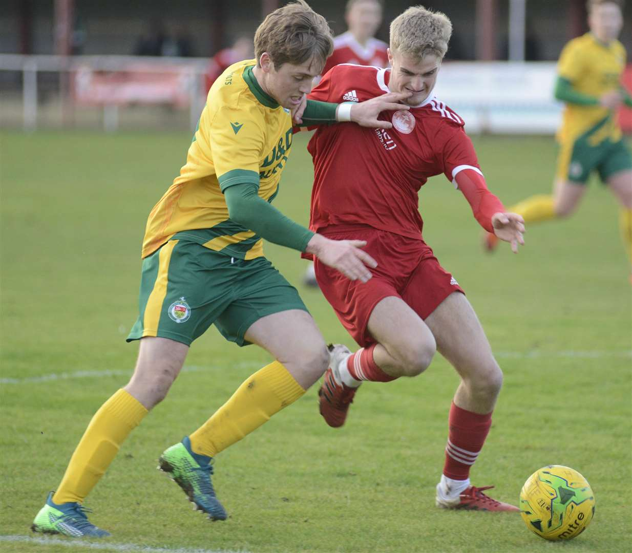 Ashford's Tom O'Connor, left, battles for possession against Hythe Picture: Paul Amos