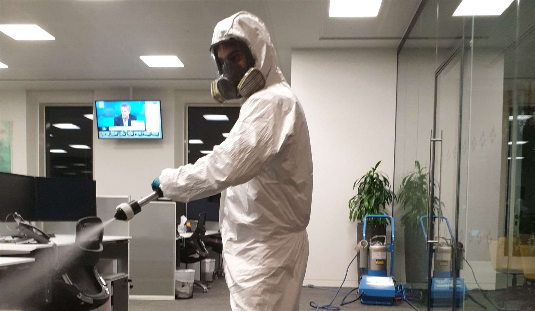 Adam Bourgeois wears protective clothing during cleaning. Credit: Ideal Response
