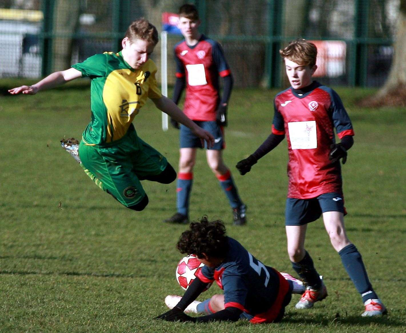 Cliffe Woods Colts under-15s (green) take evasive action against Hempstead Valley under-15s. Picture: Phil Lee FM26563336