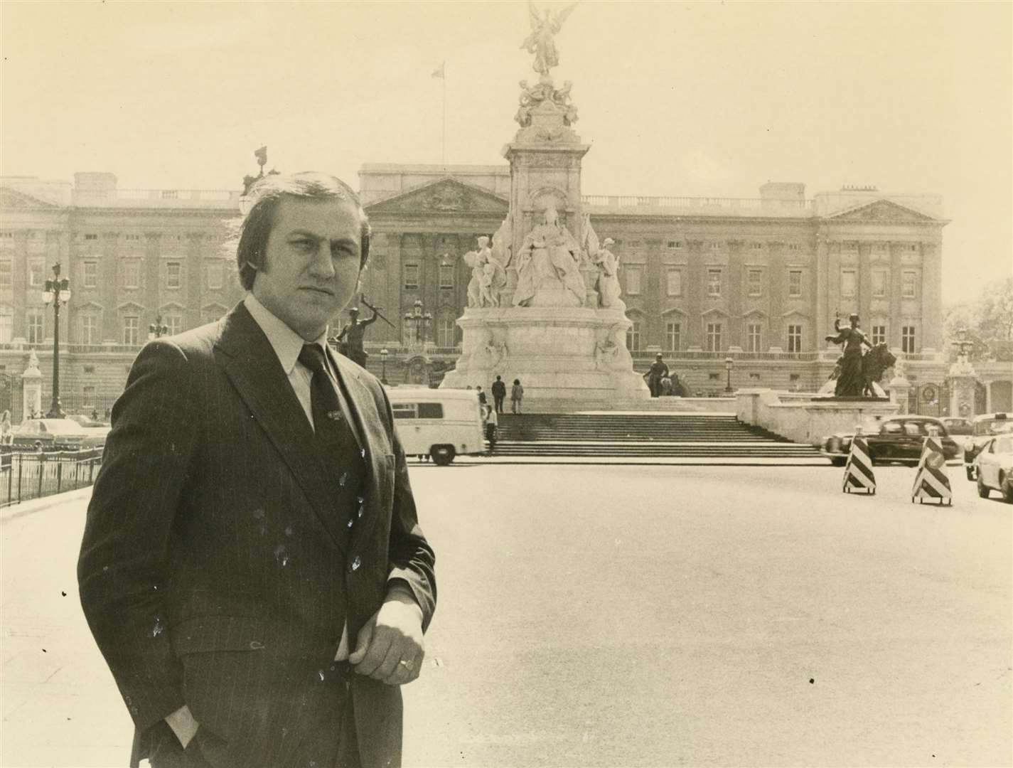 Mr Russell outside Buckingham Palace. Picture Dix Noonan Webb