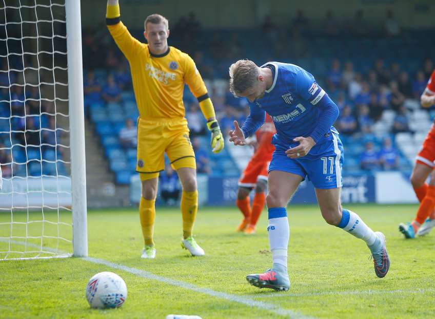 Lee Martin puts a chance wide for Gills Picture: Andy Jones