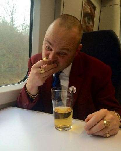 The Pub Landlord having breakfast on the train