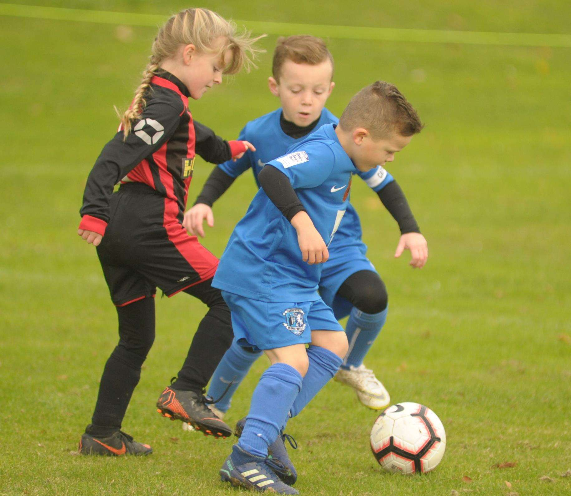 Under-8 sides Medway United West and Woodcoombe Youth battle it out Picture: Steve Crispe