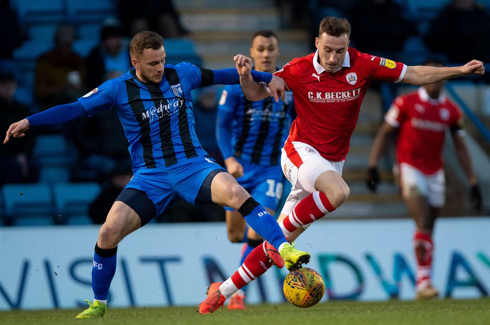 Dean Parrett gets a foot in against Mike Bahre Picture: Ady Kerry