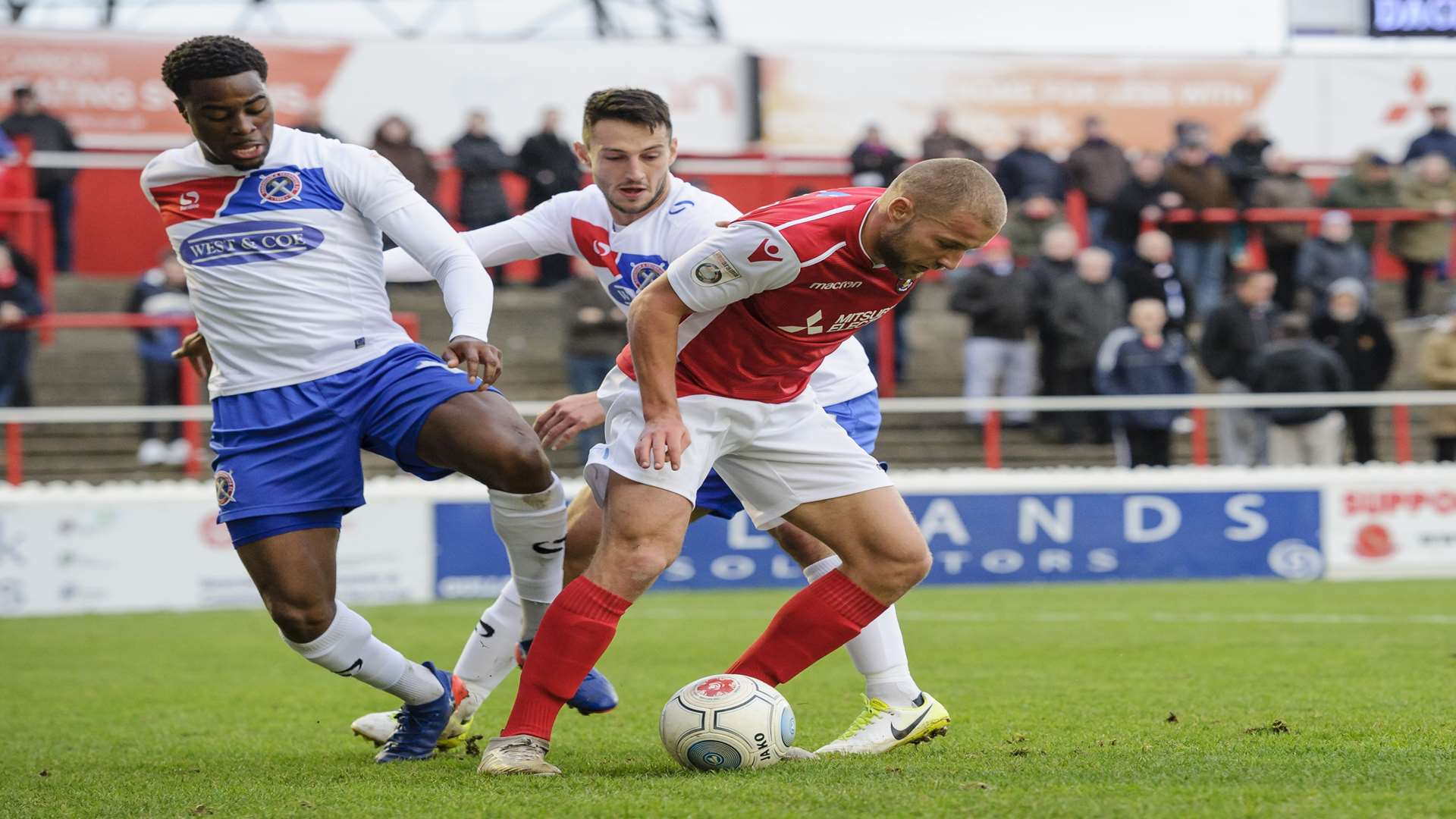 Fejiri Okenabirhie tries to dispossess Luke Coulson during Ebbsfleet's draw with Dagenham earlier this season Picture: Andy Payton
