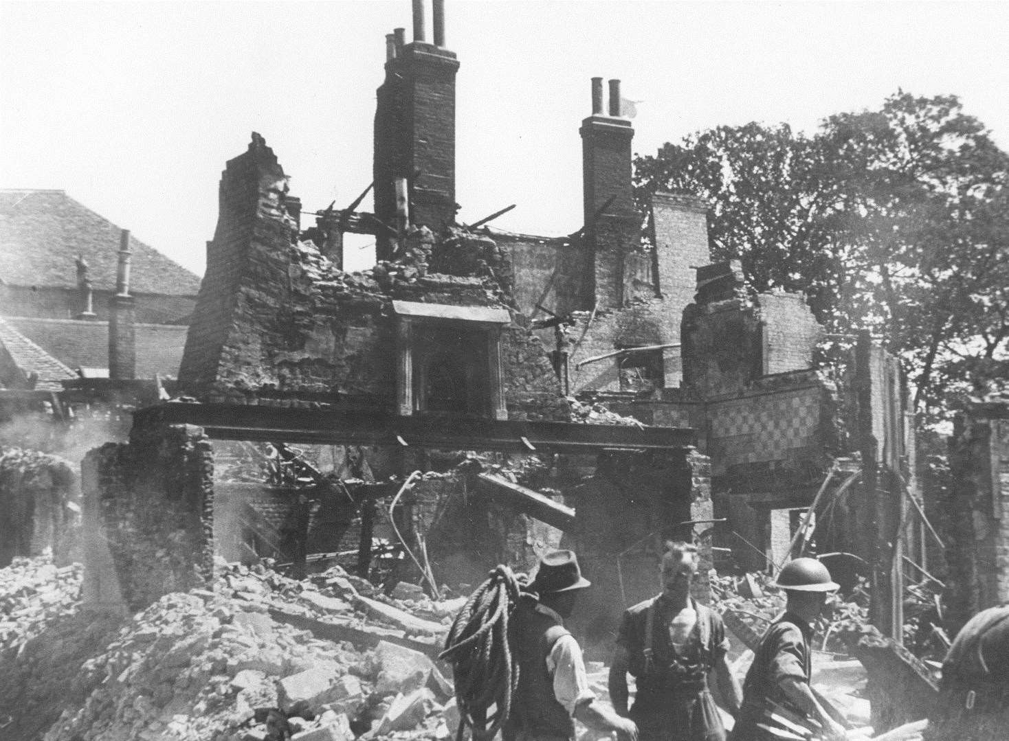 Service personnel try to find survivors in the debris that once was Dashwood's toy shop