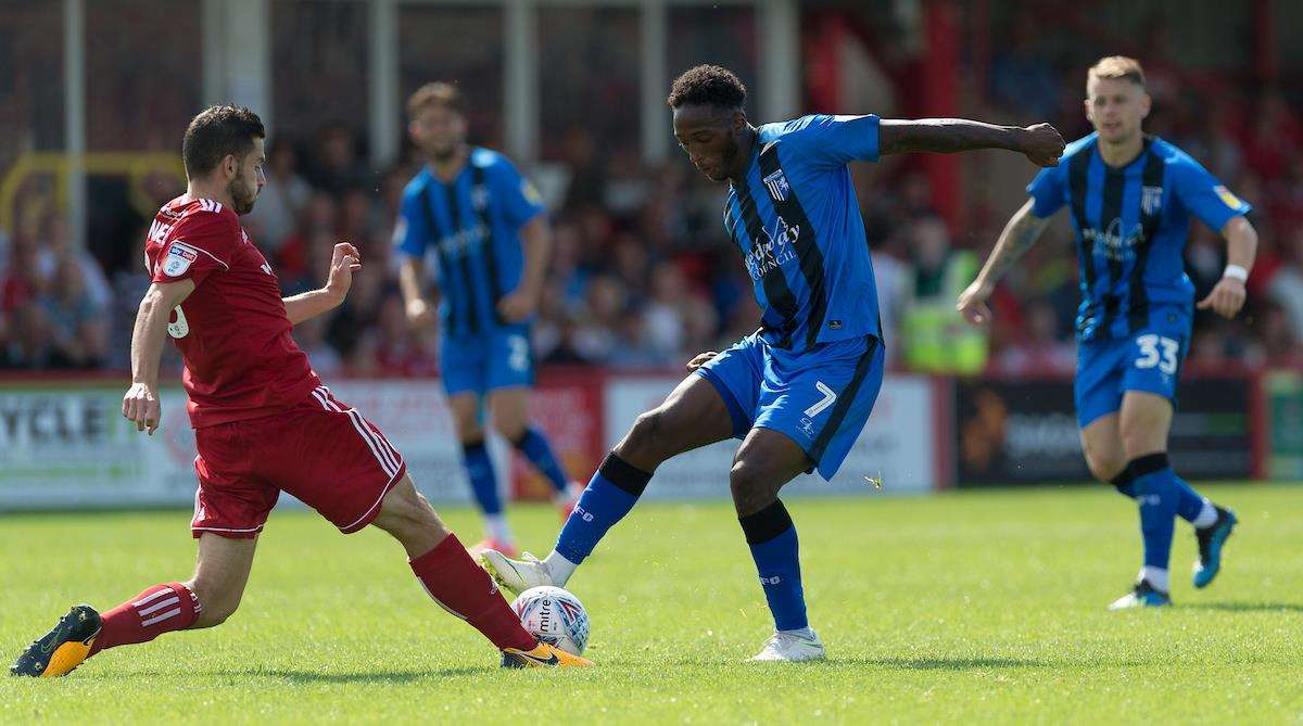 Gillingham's Brandon Hanlan challenges with Accrington's Seamus Conneely Picture: Ady Kerry