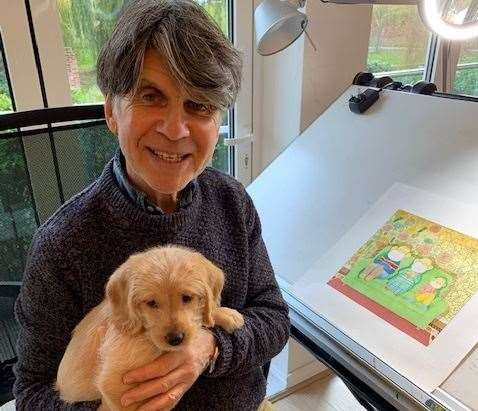 Anthony Browne is distracted from his work by new puppy Albert