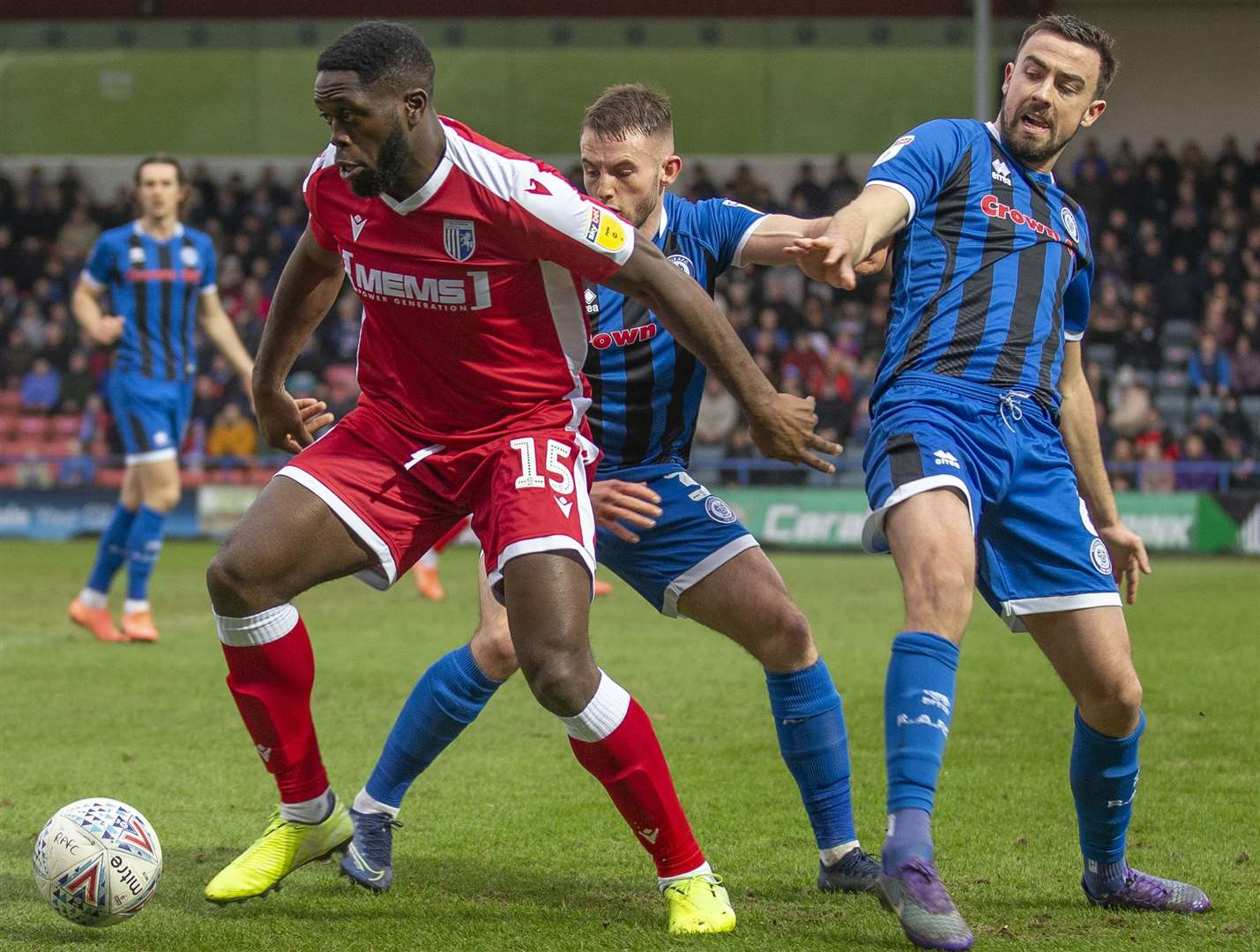 John Akinde holds off two Rochdale defenders Picture: Julian Hart