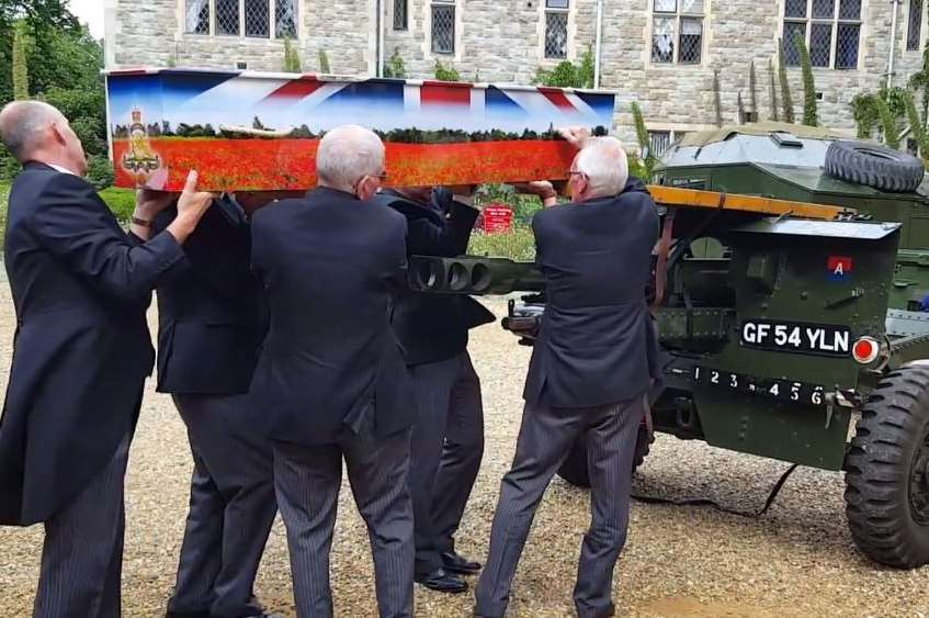 Pall bearers lift Albert Figg's special coffin from the gun carrier