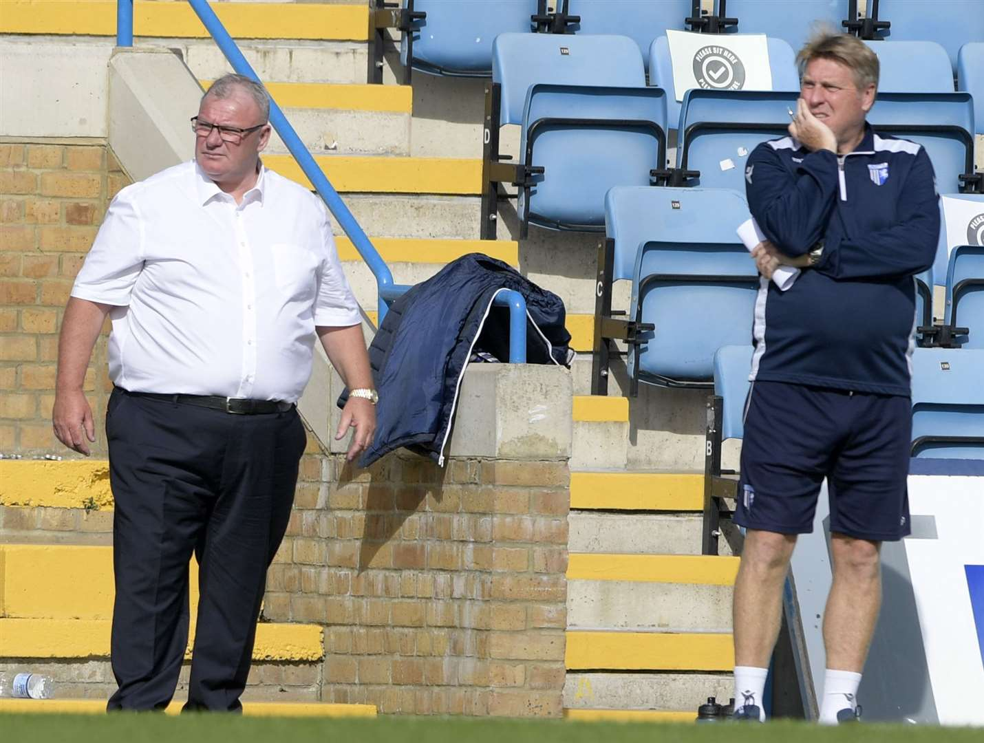 Gillingham manager Steve Evans and assistant Paul Raynor watch their team take on Hull City at the weekend Picture: Barry Goodwin