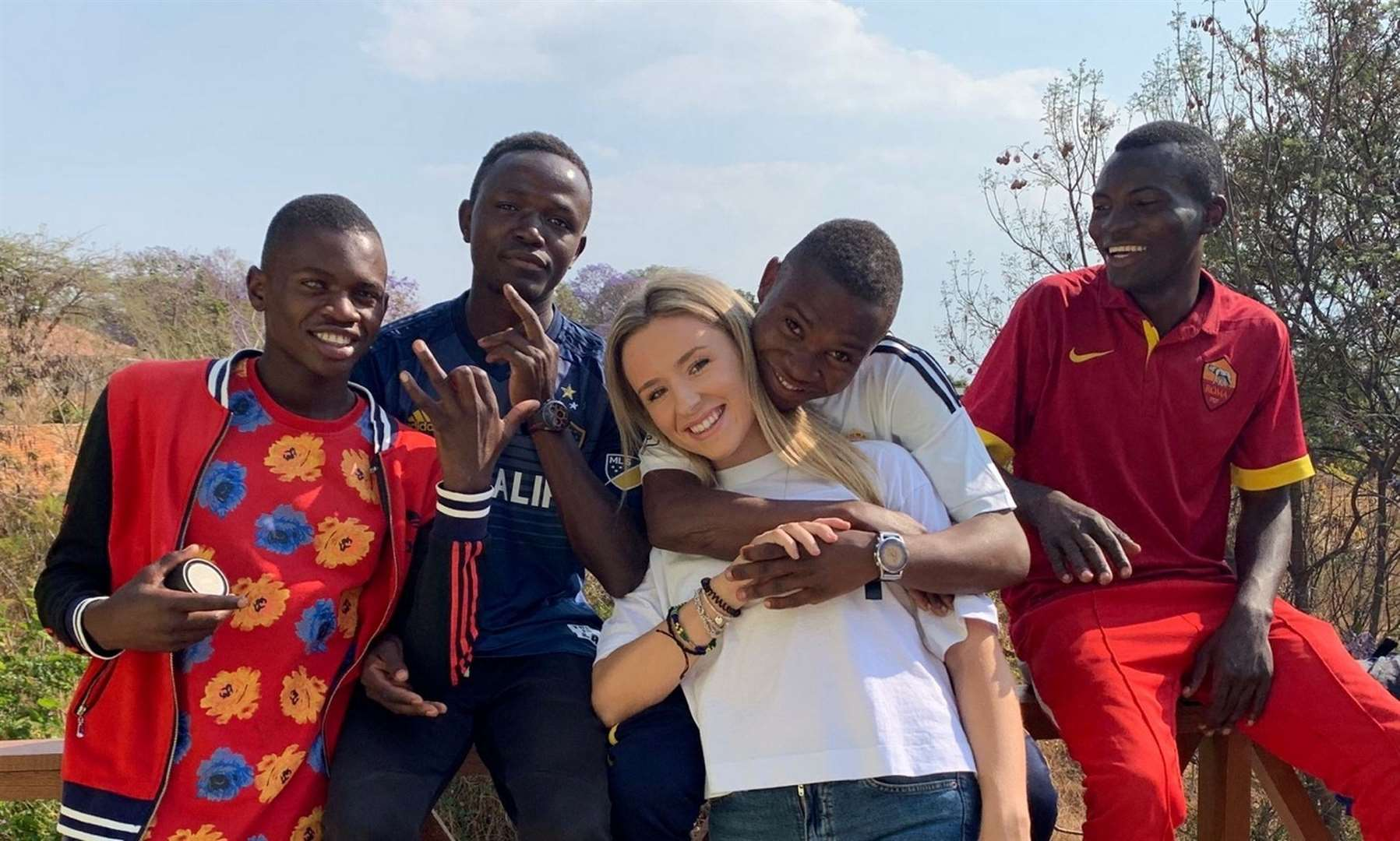 Letty with some of the Tanzanian children she met after volunteering in an orphanage on her gap year. Picture: Letty McMaster/SWNS