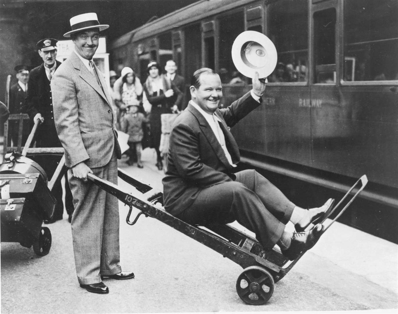 Comedy legends Laurel & Hardy lark about at Waterloo station
