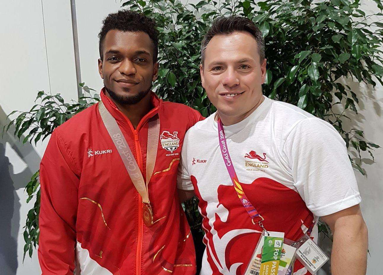 Pegasus gymnast Courtney Tulloch with coach Ionut Trandaburu after rings gold
