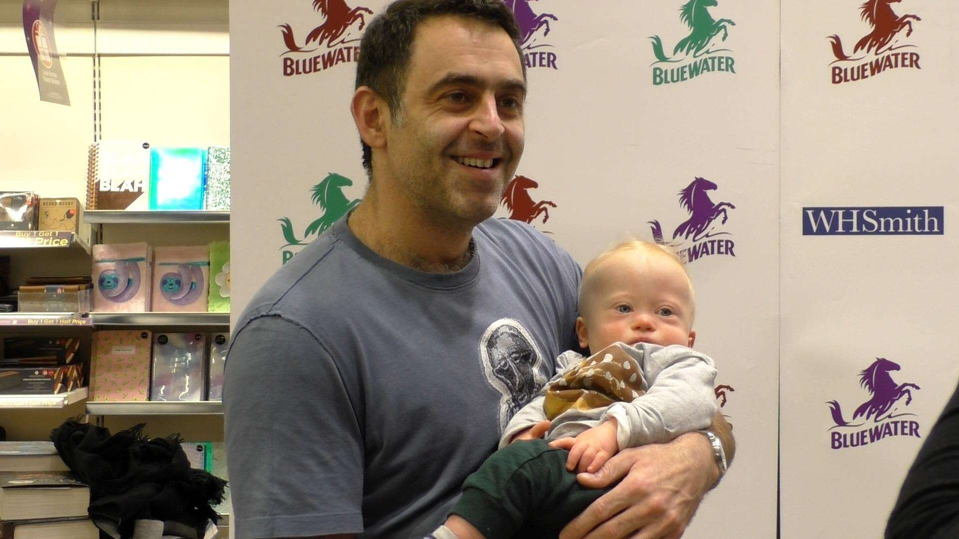Ronnie O'Sullivan also met a young fan at the book signing