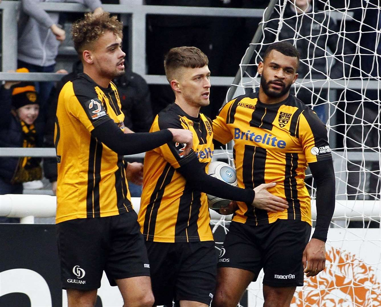 Jake Robinson, centre, with Michael Phillips and Dan Wishart after forcing Maidstone's own-goal equaliser .Picture: Sean Aidan