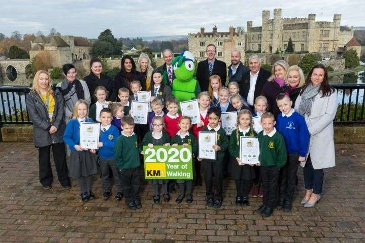 Walk-to-school and Busters Book Club challenge-day winners with representatives of organisations supporting the KM Charity Team's green-travel and literacy initiatives at Leeds Castle (22104850)