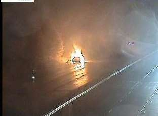 The car on fire. Picture via Highways Agency.