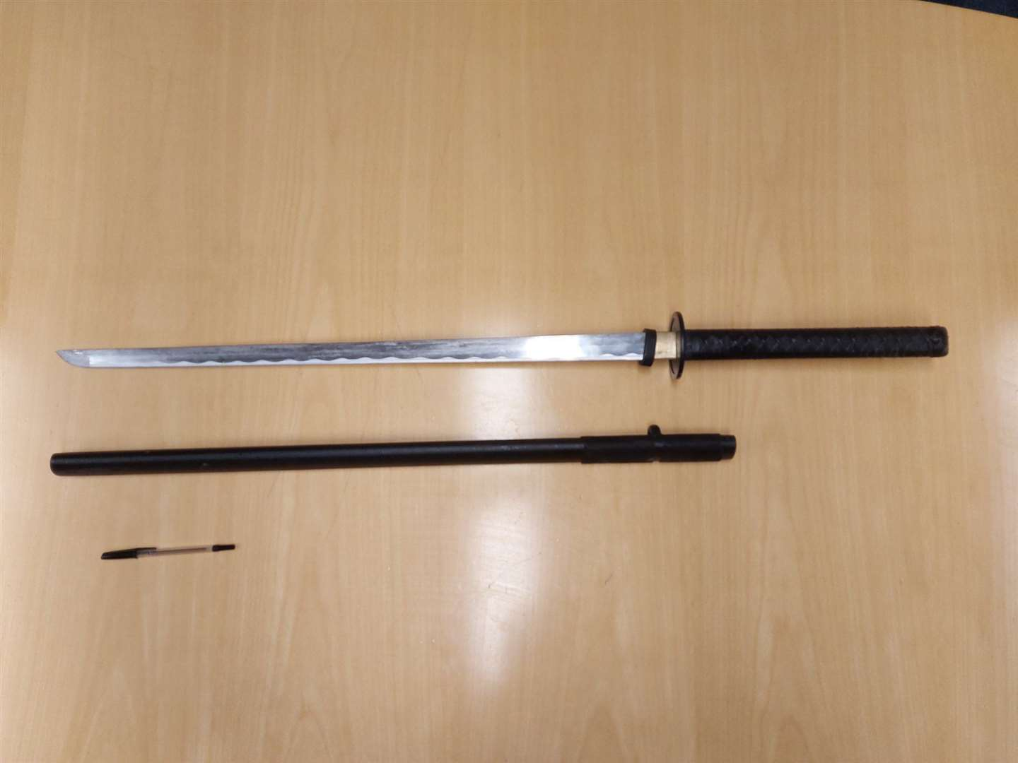 Police seized this sword after stopping a car in Tenterden, with a pen for scale. Photo: Kent Police