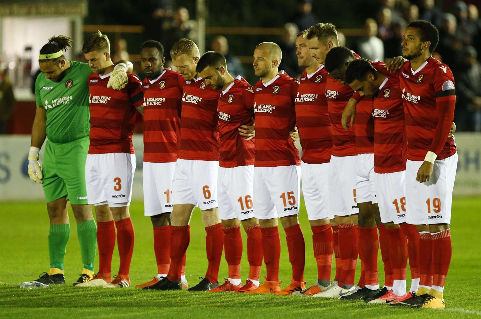 Ebbsfleet's players observing a minute's silence earlier this season. Picture: Andy Jones