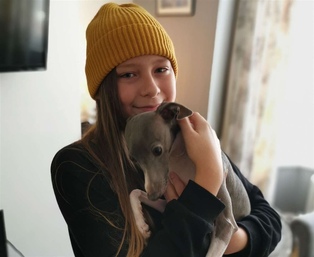 Ashley with her beloved Italian greyhound Django