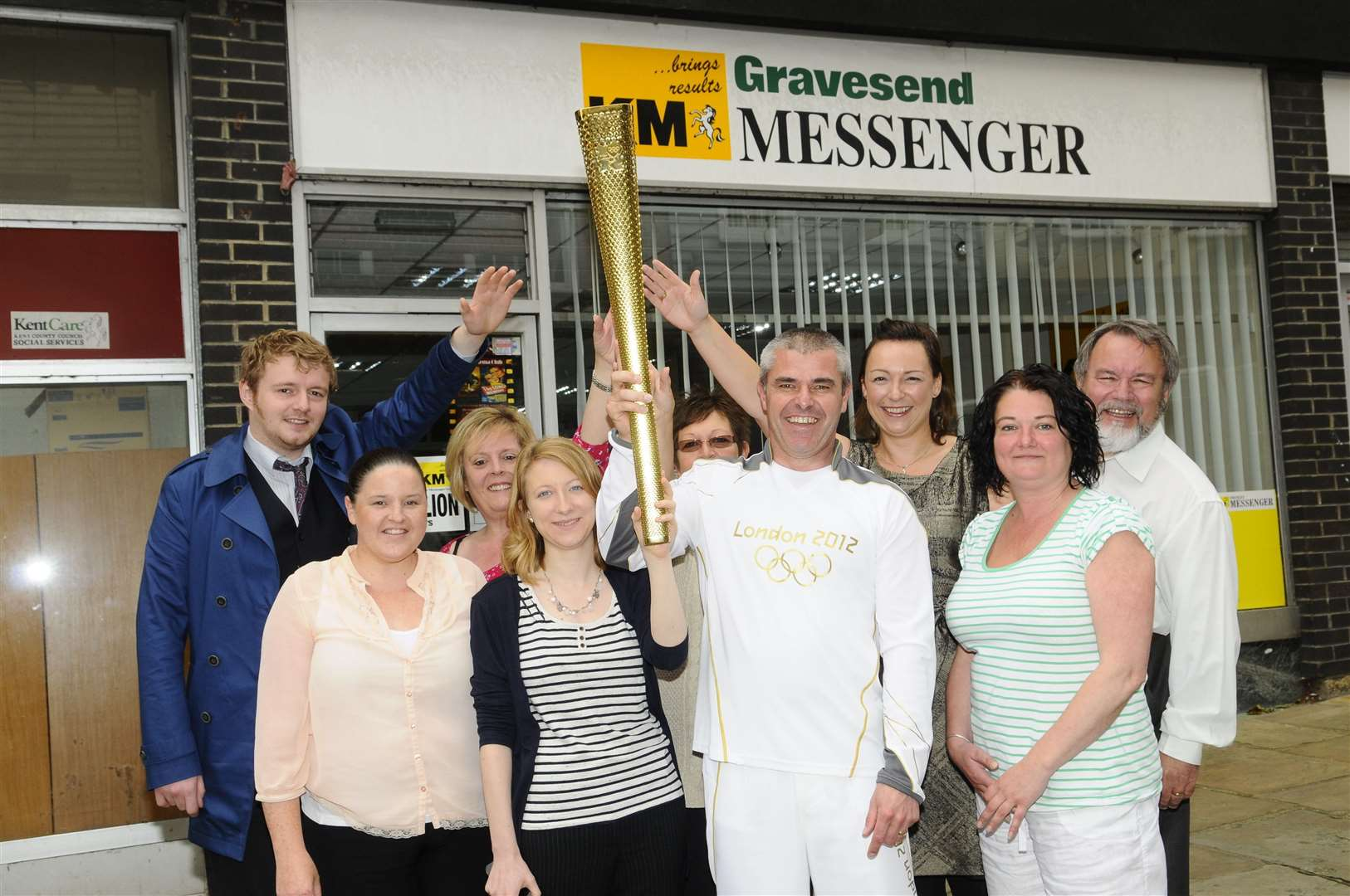 Paul Cloke, who carried the Olympic torch in Sheffield, with the KM's Gravesend Messenger team