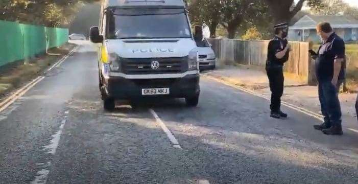 Police at Napier Barracks last month, after a group of people gathered outside the gates appearing to protest that asylum seekers moved in. Picture from Youtube account: Xx T W xX