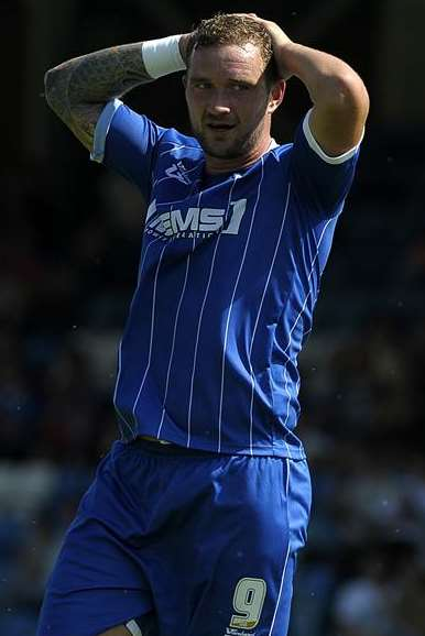 Danny Kedwell rues a missed chance in Gills' opening-day defeat