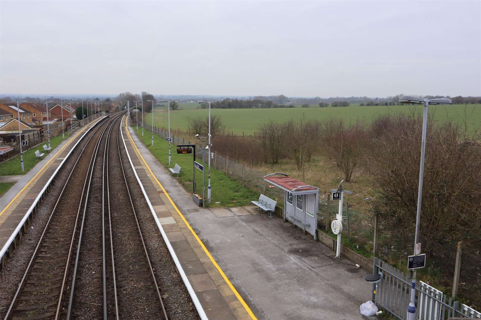 Railway lines at Kemsley Halt showing farmland to the right