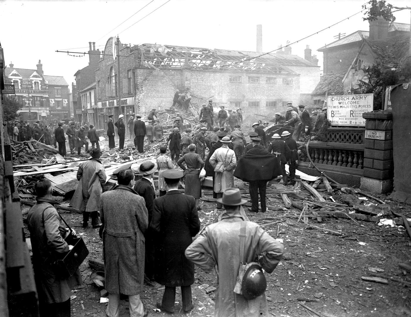 Residents look at the smouldering rubble of the Foresters Arms in Knightrider Street which was destroyed by a German bomb in 1940 Archive picture
