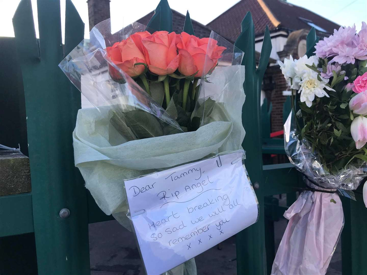 Flowers and messages have been left outside the school