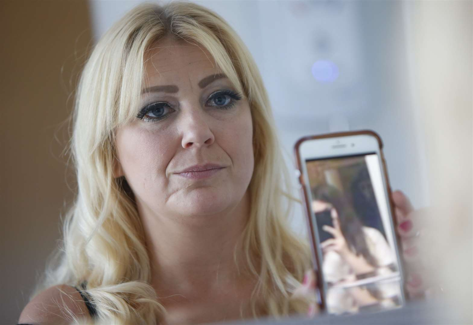 Vikki Booth is convinced her home is haunted after spotting a ghoul in a mirror selfie