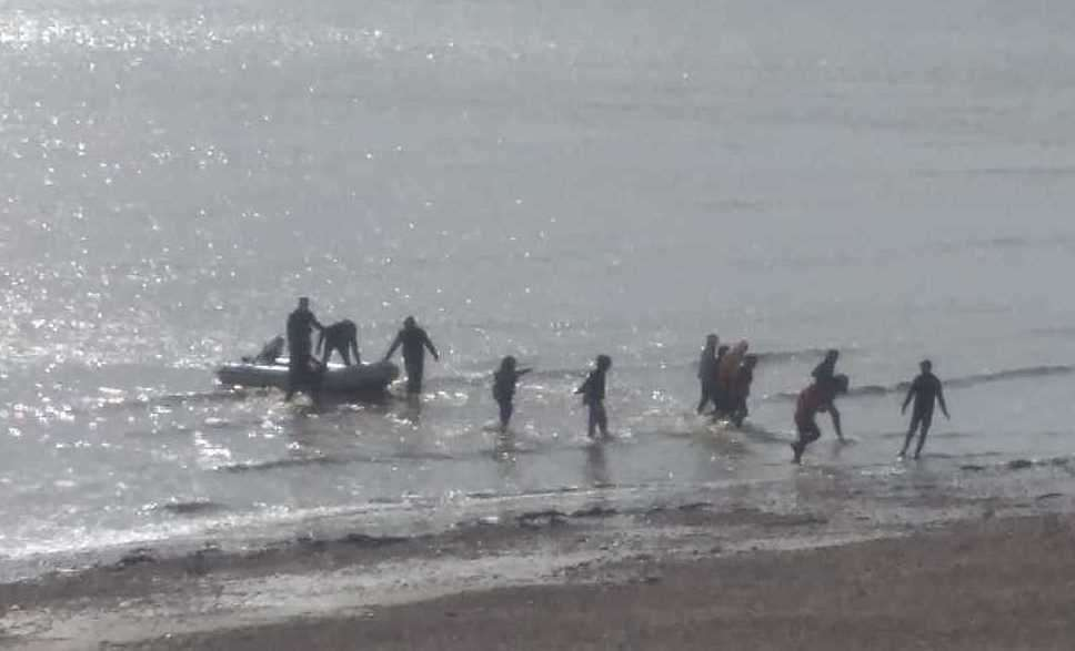 People landing on the Kinsgdown shore after crossing the Channel. Picture Christian Thrale