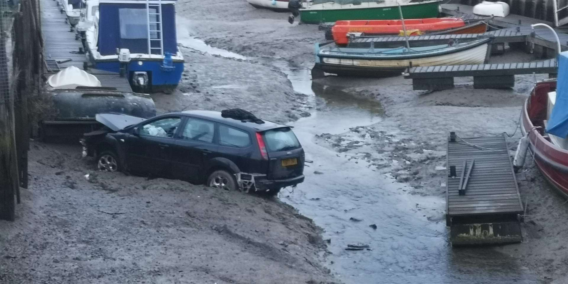 Car crashes into Oare creek by Youngs Boat Yard off The Street Oare (7057587)