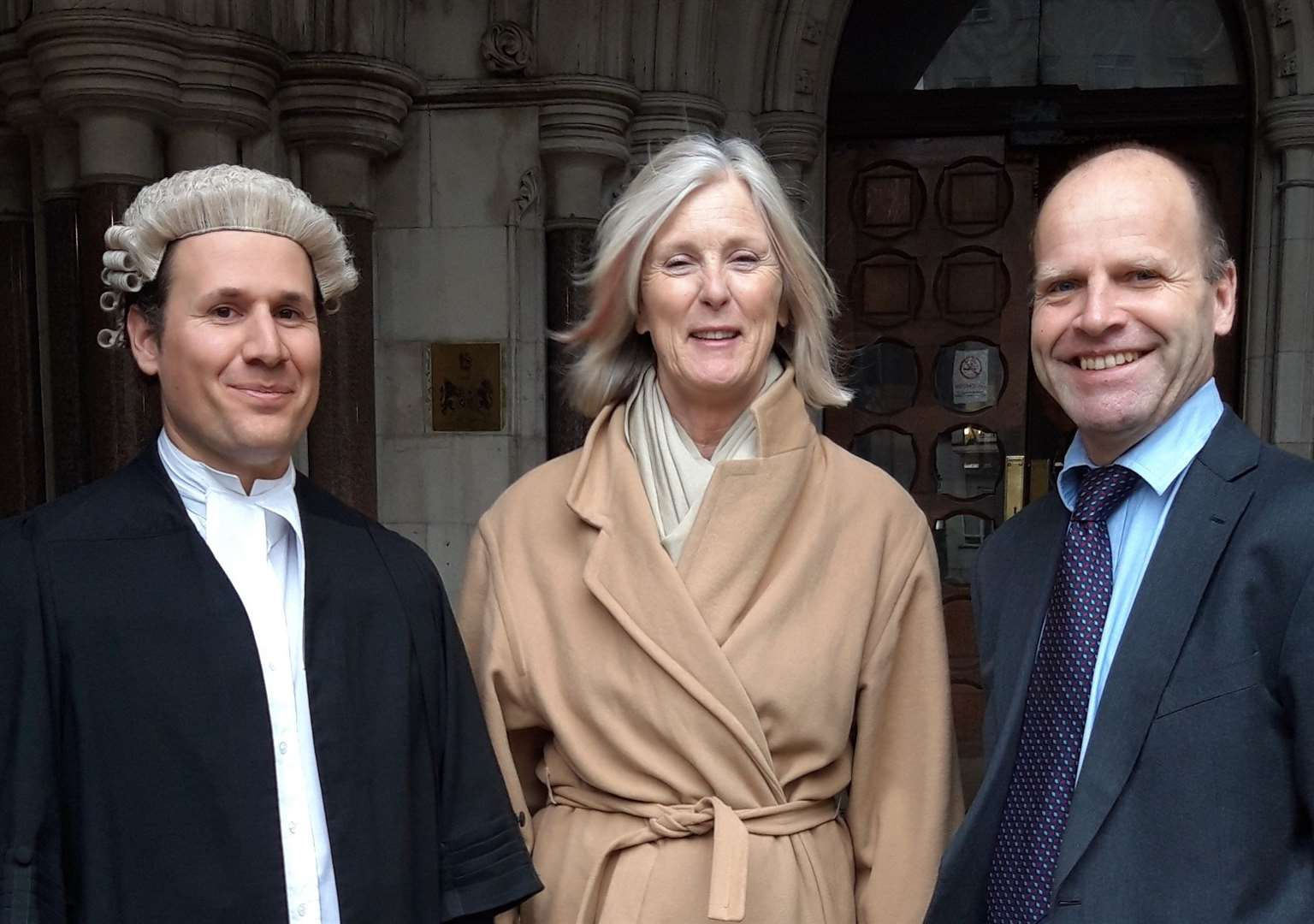 Pictured outside the High Court from left, Daniel Piccinin of Brick Court Chambers, Mrs Thomson and Paul Taylor of Richard Buxton Ltd solicitors. Picture courtesy of Goodwin Sands SOS