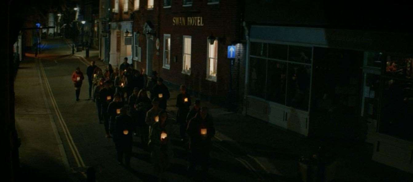 People walk past the Swan Hotel in Hythe.  Photo: BBC iPlayer