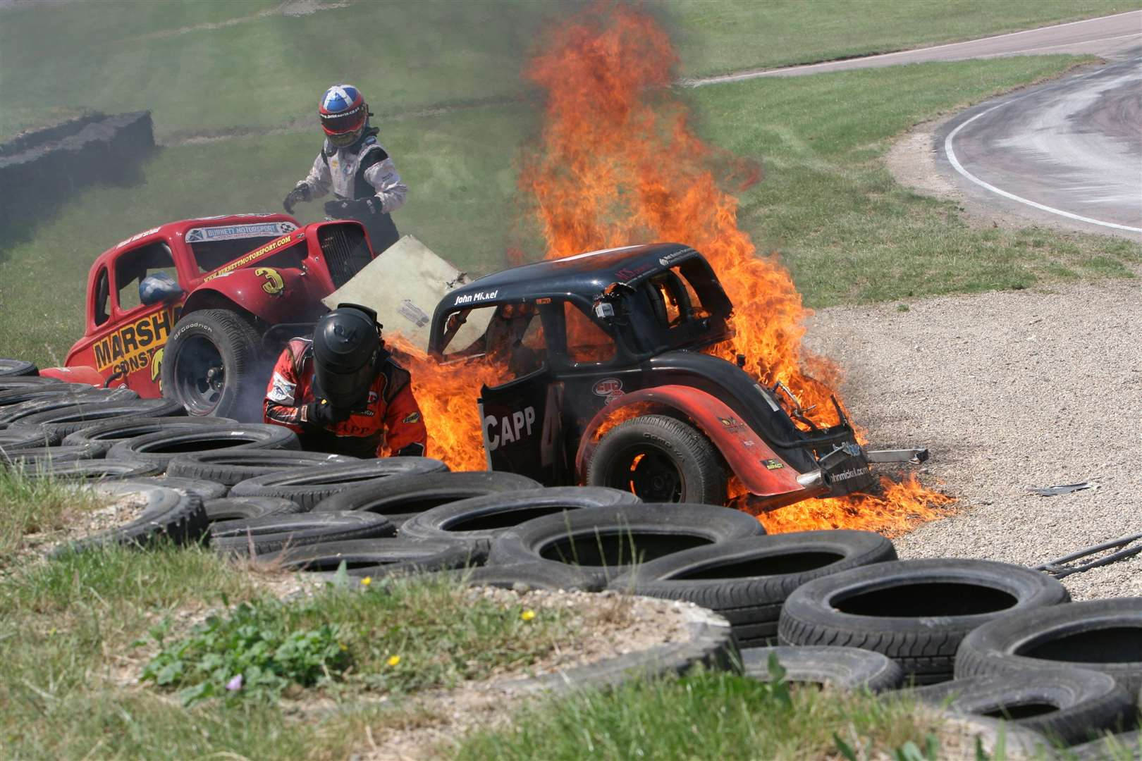 Two Legends drivers - Ross Marshall and John Mickel - were lucky to escape from this fiery crash at Lydden Hill in June 2010. Picture: Kerry Dunlop