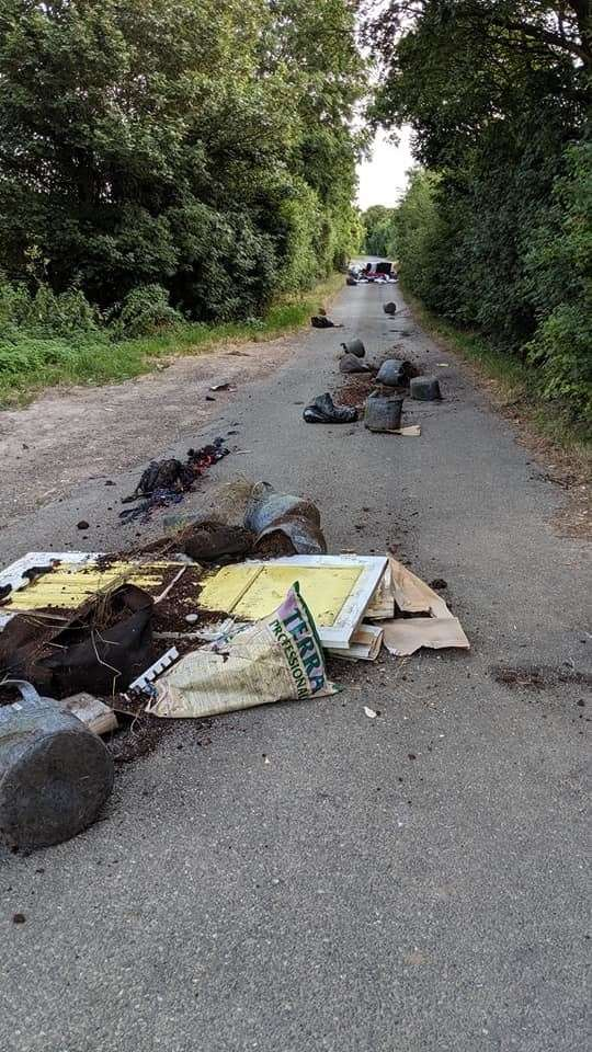 Residents have slammed the fly-tipping in Downs Road, branding it 'disrespectful'. A black leath sofa and multiple rubbish bags were dumped in Downs Road, near Gravesend Picture: Richard Rushen (13716215)