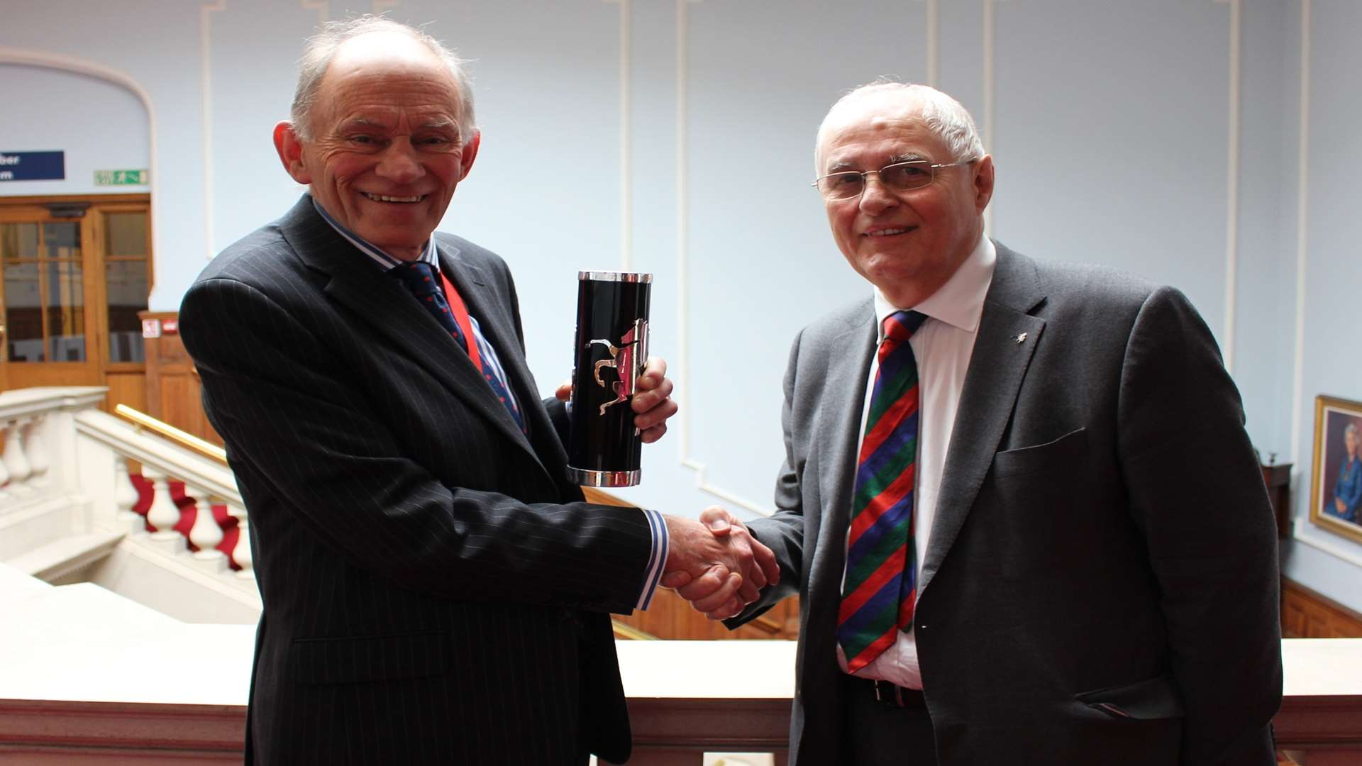 Maidstone Studios owner Geoff Miles, right, is presented with the Kent Invicta Award by KCC chairman David Brazier